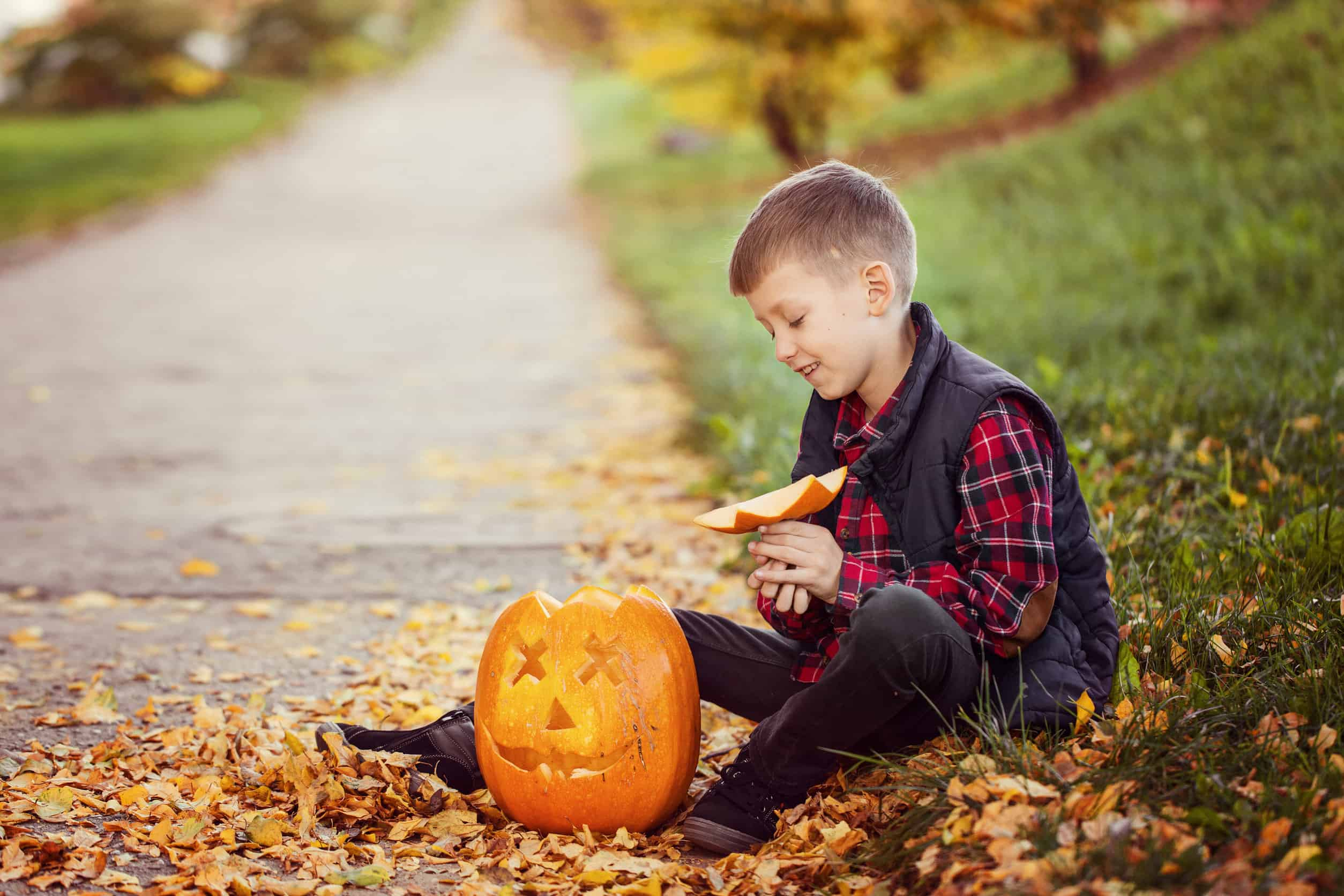 boy with carved pumpkin